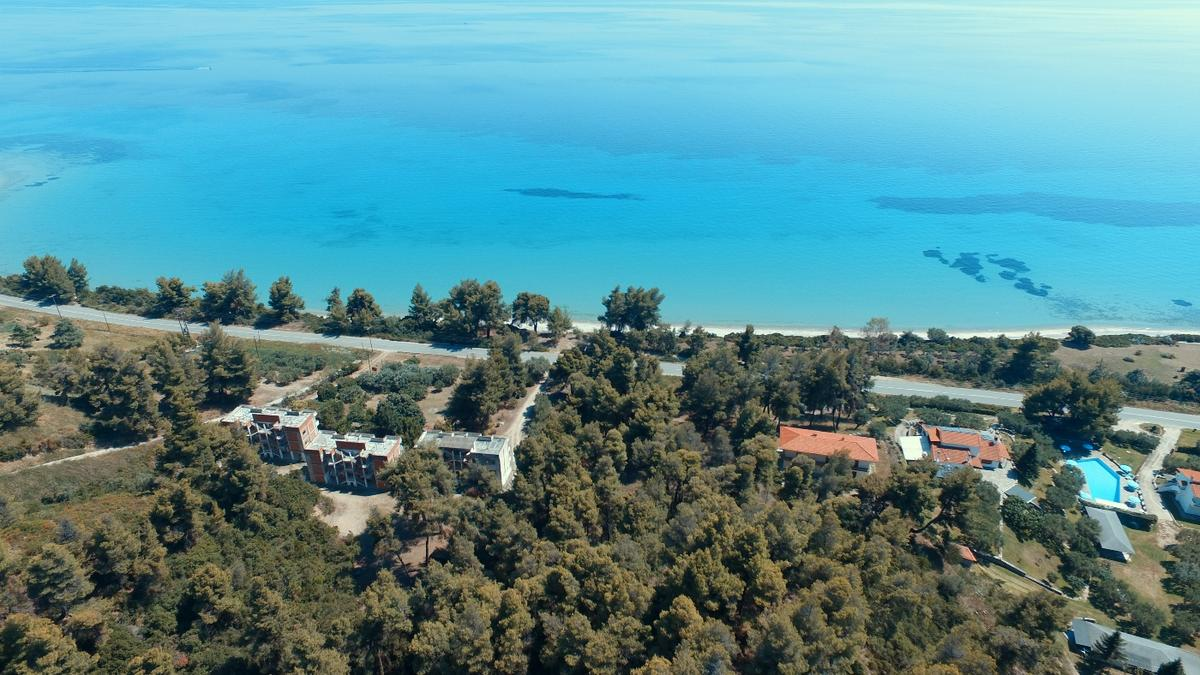 IONAS, Halkidiki-Kassandra, Greece - The picturesque land plot is situated in the pines just 50m from the sandy beach. The coefficient of residential building is 400m2;