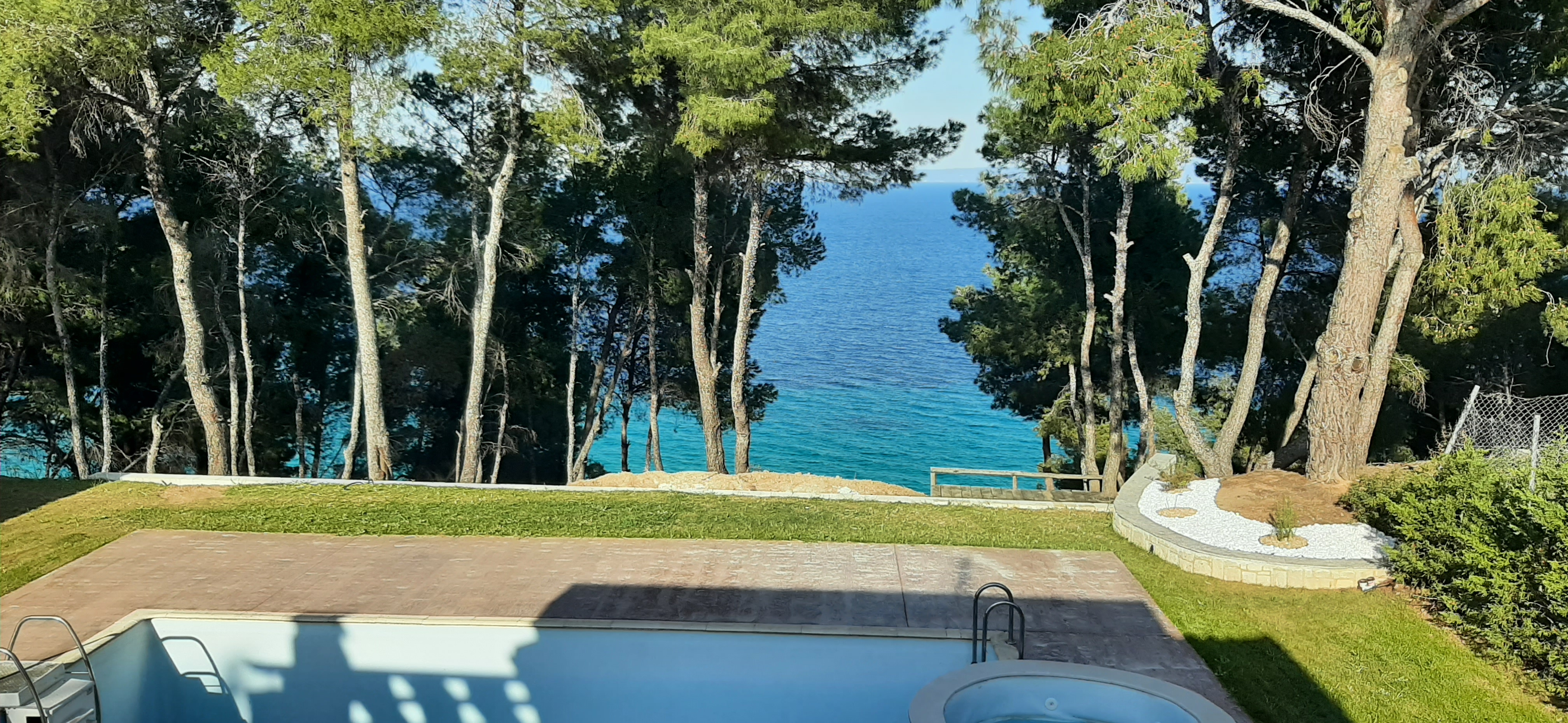 VILLA TEKTAMOS, Halkidiki-Kassandra, Greece - Exclusive villa with fully furnished private heated outdoor pools and a scenic location on the 1 line of the sea
