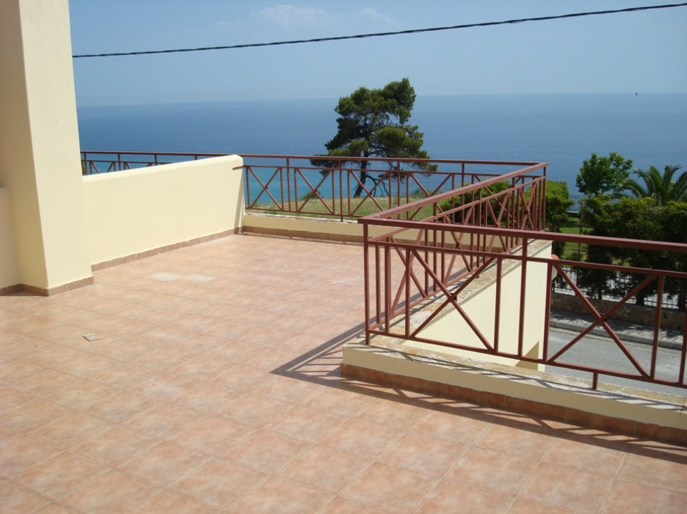 Aperanto, Halkidiki-Kassandra, Greece - Fully furnished town house with a land plot on the 1 line of the sea surrounded by beautiful pines