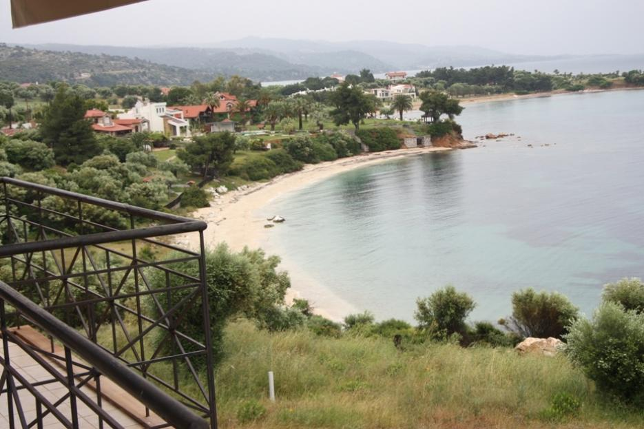 Toroneos, Halkidiki-Sithonia, Greece - The complex of 6 townhouses of natural stone at 1 line of the sea on the picturesque peninsula of Sithonia