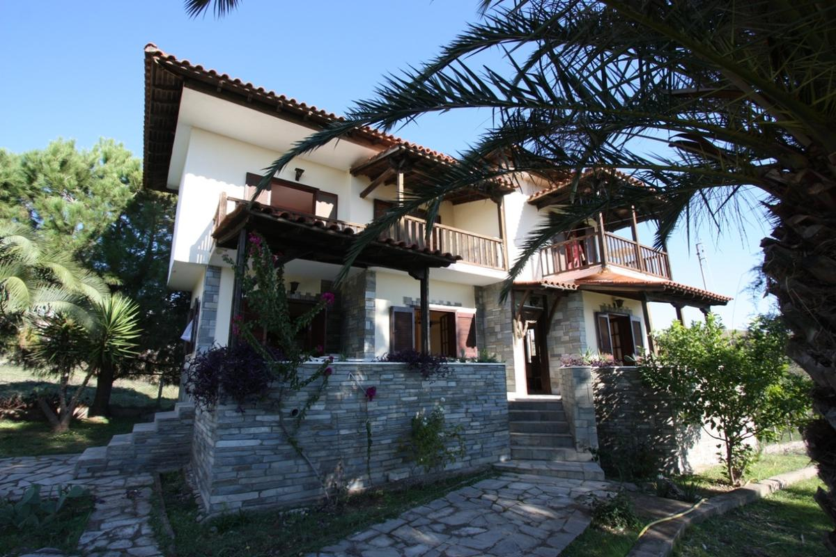Aria, Halkidiki-Sithonia, Greece - Traditional Greek house on a green area within the village