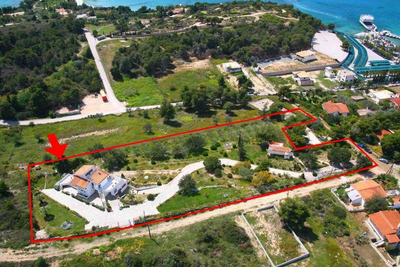 Kosta, Peloponnisos, Greece - elegant classical villa by the sea for sale