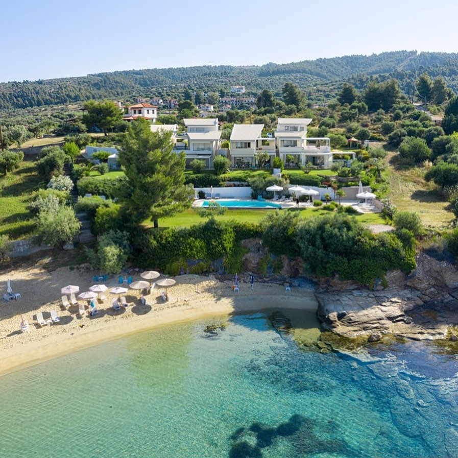 Iliovasilema, Halkidiki-Sithonia, Greece - Complex of 4 modern villas in a unique place in Sithonia on the 1 line of the sea. Ideal as an investment for the holiday rent